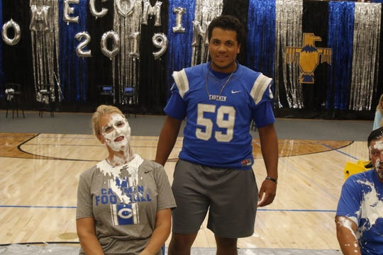 Bonnie McKenzie and her son Crimson pose after Crimson pie-faced his mother during the 2019 Carlsbad homecoming pep rally.