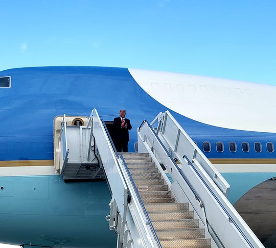 President Donald Trump steps off Air Force One Monday at Kirtland Air Force Base in Albuquerque. Eddy County Sheriff Mark Cage greeted the President after the plane touched down.