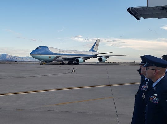 Military personnel watch Air Force One land at Kirtland Air Force in Albuquerque. Eddy County Sheriff Mark Cage greeted President Donald Trump before a campaign rally in Rio Rancho.
