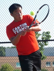 Canton #1-ranked doubles player Larry Lu returns a shot to his Salem High opponents on Sept. 17.