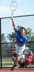 Salem High's #1 singles player Eric Liu serves during a Sept. 17 home match.