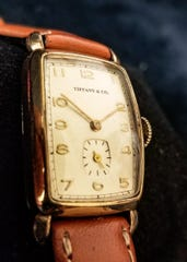 A gold Tonnueau watch with sub-second dial by Tiffany