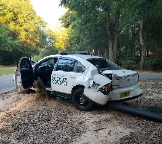 A Santa Rosa County Sheriff's Office patrol car was damaged after being rammed by a dump truck, according to authorities.