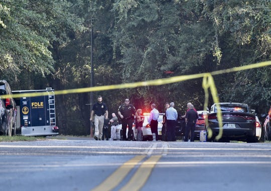 Authorities investigate a fatal officer-involved shooting Tuesday, Sept. 17, 2019, at the entrance to Pensacola State College in Milton.