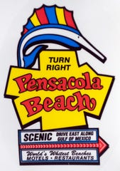 The Pensacola Beach sign is a popular logo found on items for sale in the Pensacola area.