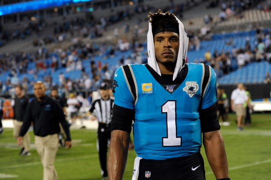 Carolina Panthers quarterback Cam Newton (1) walks off the field following the Panthers 20-14 loss to the Tampa Bay Buccaneers following an NFL football game in Charlotte, N.C.
