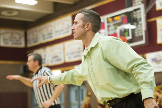 Former Mountain Pointe coach Justin Hager is seen during a game against Valley Vista on Dec. 2, 2016.