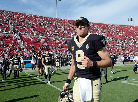 Saints quarterback Drew Brees (9) leaves the field following a 27-9 loss to the Rams on Sept. 15 at Los Angeles Memorial Coliseum.