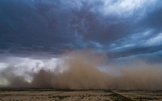 A dust storm blows across the desert from a monsoon thunderstorm near Arizona City on Sept. 16, 2019.