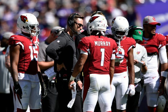 Arizona Cardinals head coach Kliff Kingsbury, center, speaks with quarterback Kyler Murray (1) in the second half of an NFL football game against the Baltimore Ravens, Sunday, Sept. 15, 2019, in Baltimore.