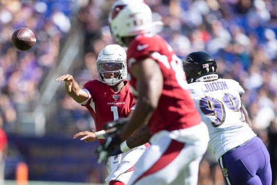 Arizona Cardinals quarterback Kyler Murray (1) throws to tight end Charles Clay (85) as Baltimore Ravens linebacker Matthew Judon (99) applies pressure during the third quarter at M&T Bank Stadium.