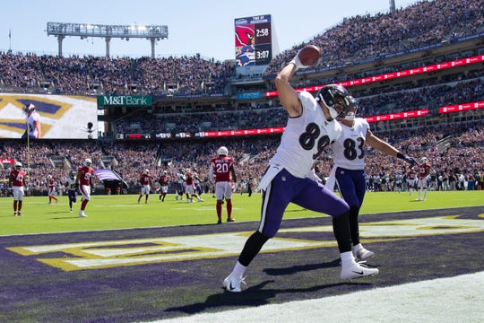 Baltimore Ravens tight end Mark Andrews (89) spikes the ball after scoring a first quarter touchdown  against the Arizona Cardinals at M&T Bank Stadium.
