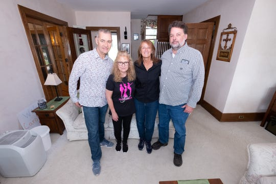 Almost five years aago, Darin Zohr, of St. Clair, right, anonymously donated bone marrow to Carol Timmins, of England, left of center. The two, pictured here in Zohr's St. Clair home with Carol's husband Paul, left, and Darin's wife Valerie, right of center, Tuesday, Sept. 17, 2019, met for the first time Sept. 9.