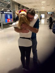 After anonymously donating bone marrow in 2014, Darin Zohr, right, of St. Clair, met Carol Timmins, of England, who received his donation, for the first time when Timmins arrived at the Detroit Metro Airport on Sept. 9, 2019.