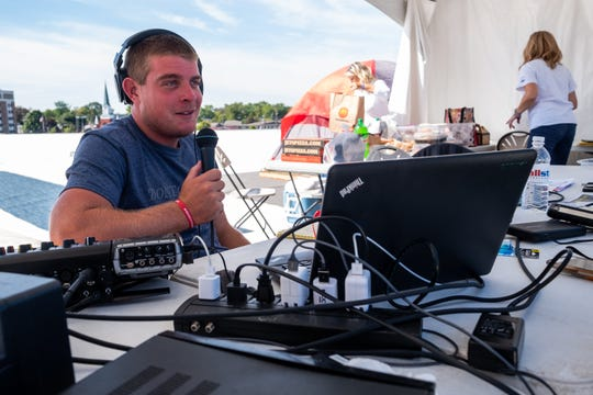 Q Country 107 WSAQ host Matt Markham broadcasts live from the roof of the Michigan Mutual building during the Community Roof-Sit for Kids' Rooftop Rally Tuesday, Sept. 17, 2019, in downtown Port Huron. This is Markham's second year participating in the event.