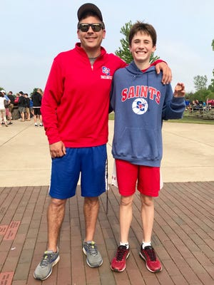 St. Clair coach Tom Brenner and runner Jack Pennewell celebrate a recent victory.
