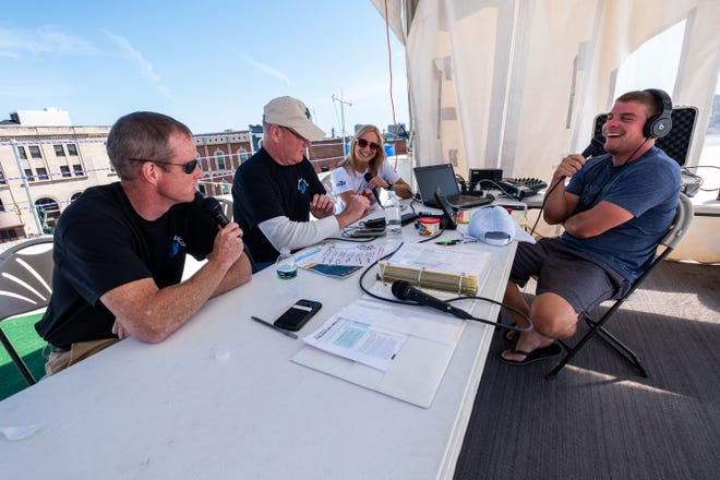 Q Country 107 WSAQ  host Matt Markham, right, broadcasts live from the roof of the Michigan Mutual building with St. Clair County Prosecutor Mike Wendling, left, Sheriff Tim Donnellon, left of center, and YMCA Vice President of Social Responsibility Liz Sawielski during the annual Community Roof-Sit for Kids' Rooftop Rally Tuesday, Sept. 17, 2019, in downtown Port Huron.
