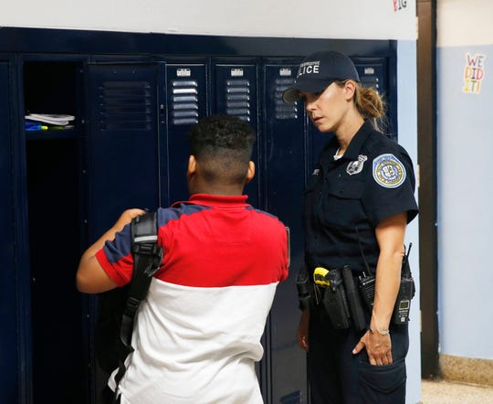 City of Poughkeepsie Police school resource officer Karen Zirbel speaks with a student inside Poughkeepsie Middle School on Tuesday.