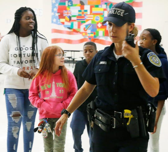 City of Poughkeepsie Police school resource officer Karen Zirbel checks her radio while at Poughkeepsie Middle School on September 17, 2019.
