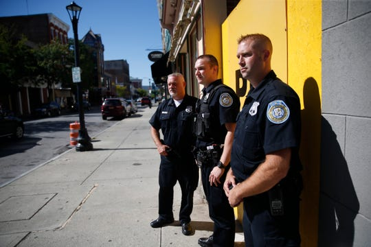 City of Poughkeepsie Police officers, from left, Mike Braren, Greg Schweizer and Kevin Van Wagner patrol Main Street on September 17, 2019. Van Wagner and Braren are assigned to the department's community policing unit.
