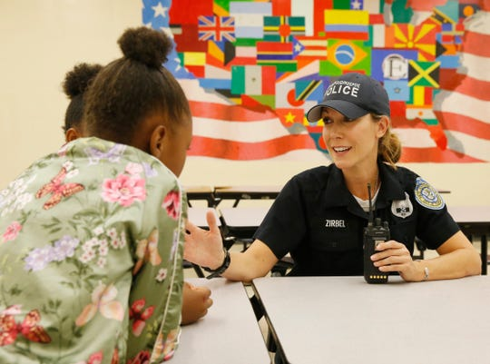 City of Poughkeepsie Police school resource officer Karen Zirbel speaks with, from left, Joshaline Parker and Anastazia Banks about the upcoming Friday Night Lights event at Poughkeepsie Middle School on September 17, 2019.