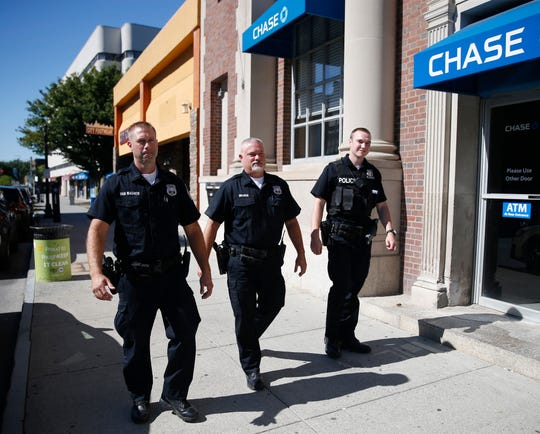 City of Poughkeepsie Police officers, from left, Kevin Van Wagner, Mike Braren and Greg Schweizer patrol Main Street on September 17, 2019. Van Wagner and Braren are assigned to the department's community policing unit.