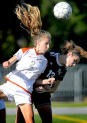 Central York's MacKenzie Stephens and Dallastown's Katy Jones fight for a header during girls' soccer at Dallastown Tuesday, Sept. 17, 2019. Bill Kalina photo