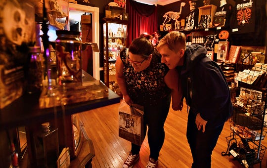 Lisa Young, left, and Amanda Blevins, both of York Township, explore the oddities inside The Dark Parlour Haus of Obscurities in York City, Saturday, Sept. 14, 2019. Dawn J. Sagert photo