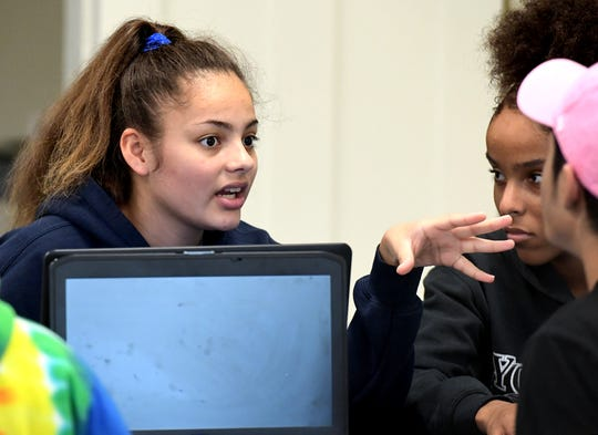 York County School of Technology junior Inna Corcuera-Melo, left, and sophomore Keysha Stuckey chat with other students during a Quantum Opportunity Program session at the York College Center for Community Engagement Monday, Sept. 16, 2019. The program, which provides academic assistance to students, is offered through a partnership between York College and the York YWCA. Bill Kalina photo