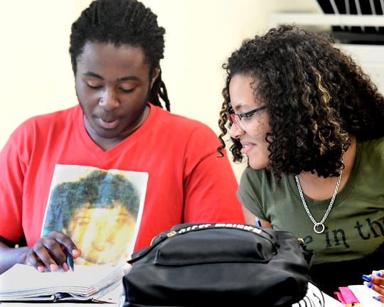 York High seniors Michael Parker and Janneishaly Torres looks at work during a Quantum Opportunity Program session at the York College Center for Community Engagement Monday, Sept. 16, 2019. The program, which provides academic assistance to students, is offered through a partnership between York College and the York YWCA. Bill Kalina photo
