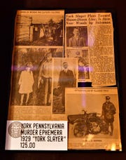 Newspaper clippings about the York Slayer available at The Dark Parlour Haus of Obscurities in York City, Saturday, Sept. 14, 2019. Dawn J. Sagert photo