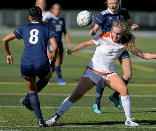 Central York's Ava Myers stops an advance by Dallastown's Madelyn Rodriguez (8) during girls' soccer at Dallastown Tuesday, Sept. 17, 2019. Bill Kalina photo