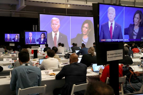 Democratic presidential candidates former Vice President Joe Biden and U.S. Sen. Kamala Harris (D-Calif.) are seen on television screens in the media workroom during the Democratic Presidential Debate at Texas Southern University's Health and PE Center on Thursday, Sept. 12, 2019 in Houston, Texas. (Justin Sullivan/Getty Images/TNS)