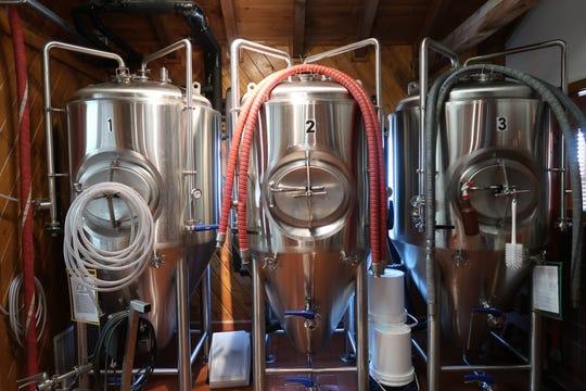 Three fermenters inside Rohrbach's Buffalo Road Brewpub.