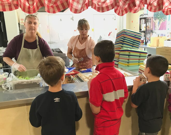 Donna Brooks, left, and Denise Murray serve lunch to students in the cafeteria at Black Butte Elementary School in Shingletown on Tuesday, Sept. 17, 2019. More students are enrolled in the Black Butte School District this year.