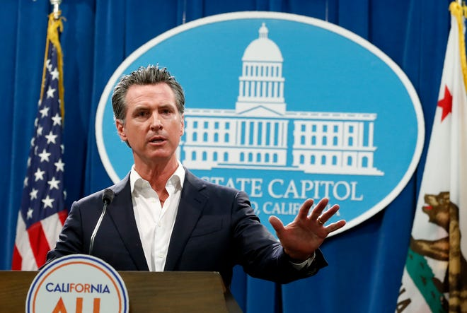 Gov. Gavin Newsom, shown at the state Capitol, says he'll veto SB 1, which legislative Democrats championed as a pushback against Trump administration environmental law rollbacks.