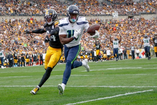 Seattle Seahawks wide receiver D.K. Metcalf (14) makes a catch past Pittsburgh Steelers strong safety Terrell Edmunds (34) for a touchdown in the second half of an NFL football game Sunday, Sept. 15, 2019, in Pittsburgh. The play was reviewed and let stand as a touchdown.