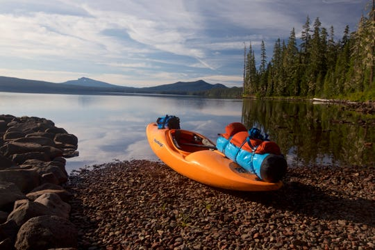 A kayak loaded up for a trip to one of the boat-in, or dispersed campsites, at Waldo Lake.