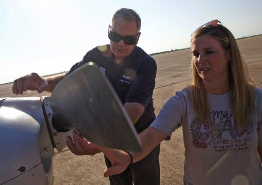 Terry Pricer, center, checks the propeller of a Civil Air Patrol aircraft with local teacher Kristin Gentry on Saturday, Sept. 14, 2019.