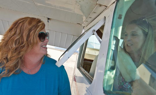 Tammy Davis, left, and Kristin Gentry share a moment before Gentry's flight with the Civil Air Patrol on Saturday, Sept. 14, 2019.