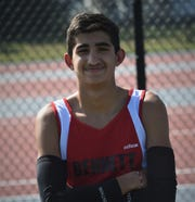 James M. Bennett track and cross country athlete Yousuf Al Naseri poses for a photo on Sept. 16, 2019.