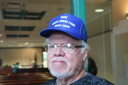 "A man sports a ""Make White Horse Park Great Again"" cap at the Worcester County Commissioners meeting Sept. 17, 2019. The Berlin campground subdivision's residence have been told they cannot live there year round."