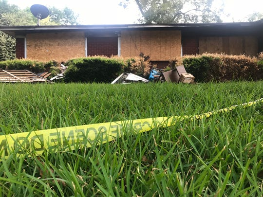 Crime scene tape and debris is seen outside the Alison Avenue home on Tuesday, Sept. 17, that caught fire on July 9, 2019.