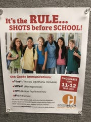 This flyer from the South Dakota Department of Health hangs in the offices of Black Hills Pediatrics in Rapid City and recommends that children get vaccinated against HPV in addition to other vaccinations that are required before enrollment in sixth grade in public schools.