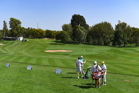 Golfers practice ahead of the Sanford International Tournament on Tuesday, September 16, at the Minnehaha Country Club in Sioux Falls.