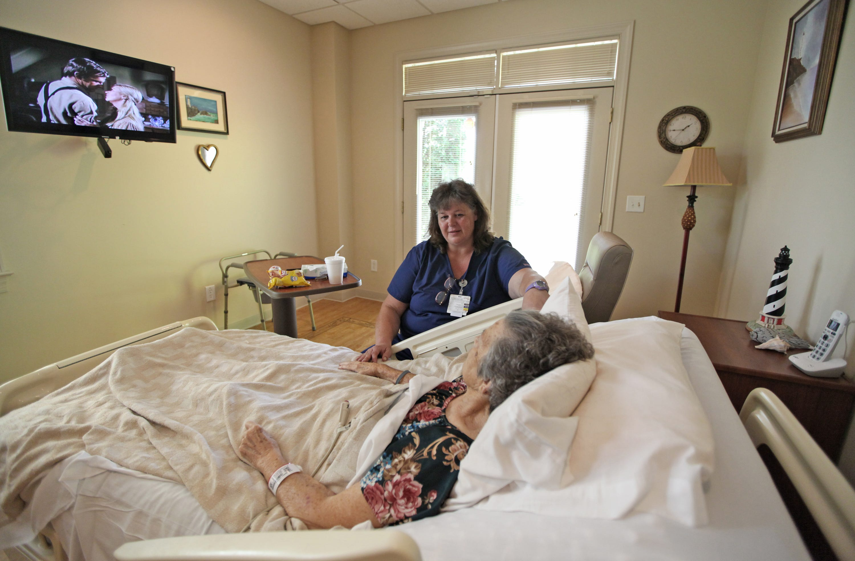 """Jody Warwick, a nurse at Augusta Health's Shenandoah House, meets with patient Geneva Wimer. Warwick was managing Wimer's colon cancer treatment and preparing her to transition back home. Shenandoah House provides assistance for patients during their end-of-life care.  """"The hope of hospice is to get patients home,"""" Warwick said, and in Wimer's case they were able to do that.  Shenandoah House also offers respite care. A hospice patient may stay for a week to give the primary caregivers some time off from the rigors of taking care of a loved one."""