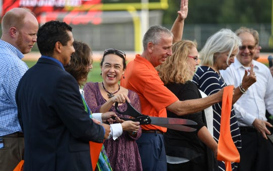 Officials cut a ribbon during the grand opening ceremony for the new Tech High School Monday, Sept. 16, 2019, in St. Cloud.