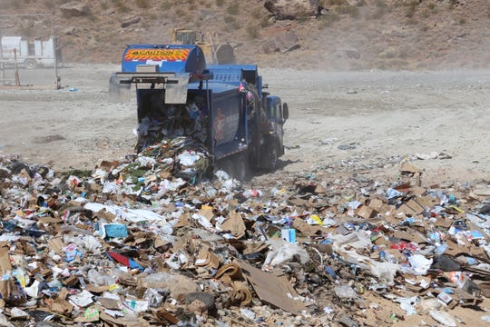 A Republic Services collection truck dumps a load at the county landfill.