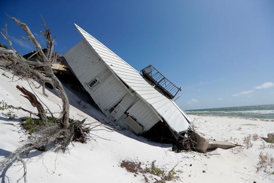 11 months since Hurricane Michael tore through the Panhandle a collapsed home propped up on a sand dune remains on Dog Island.