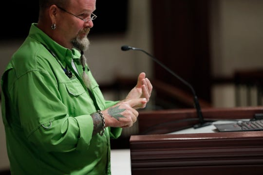 Director of Green Earth Cannaceuticals Scott Burgett speaks to the Senate Agriculture Committee during a hearing on hemp at the Capital Tuesday, Sept. 17, 2019.